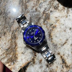 Invicta silver watch with blue face